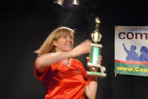 Kim proudly displays the trophy
