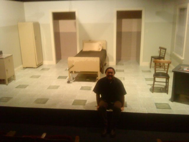 The set designer is Craig Napoliello